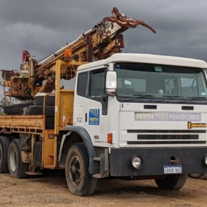 Truck with power pole attachment